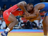Jordan Burroughs (left) and Francisco Daniel Soler Tanco compete in a men's freestyle 74-kilogram match during the London Olympics at ExCeL on Aug. 10, 2012.