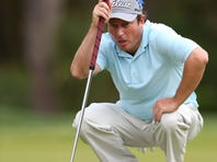 Tim Clark of South Africa lines up a putt on the 13th hole during the second round of the RBC Heritage.