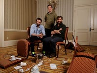 Bradley Cooper, left, Ed Helms and Zach Galifianakis pose reunite for one final debauched adventure in 'The Hangover Part III.'