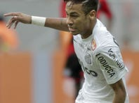 Santos' Neymar runs with the ball during a Brazilian soccer championship match against Flamengo in Brasilia, Brazil.
