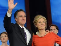 Mitt Romney and his wife, Ann, wave to supporters after he was defeated by President Obama in the 2012 election.