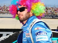 Defending champion Jimmie Johnson sported a rainbow wig during the 2012 FedEx 400 benefiting Autism Speaks at Dover International Speedway.