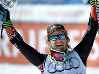 Ted Ligety of the United States shows off the crystal globe trophy of the men's alpine skiing giant slalom at the World Cup finals in Lenzerheide, Switzerland, March 16.
