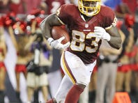 Washington Redskins tight end Fred Davis (83) runs with the ball against the Tampa Bay Buccaneers during the second half at Raymond James Stadium in 2012. Washington Redskins defeated the Tampa Bay Buccaneers 24-22.