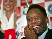 Pele, right, and Nabil Sultan, vice president of Emirates Airline, smile during a press conference on June 4 in New York.