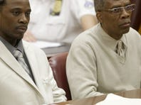 Vincent George Jr., left, and Vincent George Sr., listen to closing arguments in a courtroom in New York, June 6.