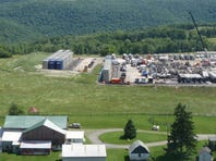 A farmhouse sits next to a fracking site near Tioga County, Pa.