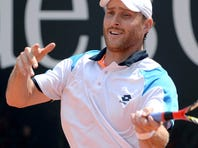 Michael Berrer  of Germany fires a forehand during his victory against Jeremy Chardy of France.