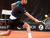 Benoit Paire  of France  lines up a backhand during his victory Thursday against Nikolay Davydenko of Russia .