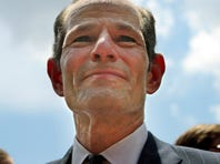 In this July 8, 2013, file photo, Eliot Spitzer appears in New York's Union Square to collect signatures for his race for New York City Comptroller.