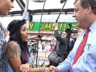 "New Jersey Gov. Chris Christie shakes hands with MTV ""Jersey Shore"" cast member Nicole ""Snooki"" Polizzi as castmate Jennifer ""JWoww"" Farley looks on after they met  Friday morning on the Seaside Heights, NJ, boardwalk on May 24, 2013."