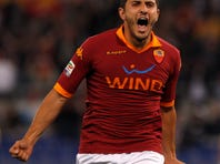 AS Roma midfielder Marquinho, of Brazil, celebrates  during a Serie A soccer match between AS Roma and Napoli, at Rome's Olympic stadium, Sunday, May 19, 2013.