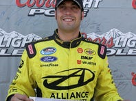 Sam Hornish Jr. holds the pole position banner after winning the pole for the NASCAR Nationwide Series STP 300 at Chicagoland.