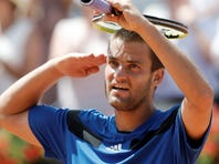 Mikhail Youzhny of Russia defeats Robin Haase of Netherlands to win the Swiss Open on Sunday in Gstaad, Switzerland.