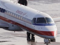 An American Eagle flight was forced to make an emergency landing Tuesday when crew noticed smoke in the cockpit and cabin.