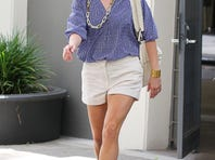 Mom-of-three Reese Witherspoon, 37, seen in L.A. in May, balances her shorts with a long-sleeve button-down and flat sandals.