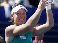 Samantha Stosur of Australia hoists the trophy after beating Victoria Azarenka of Belarus to win the Southern California Open.