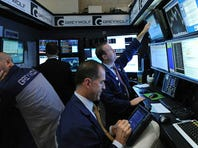 Trader Robert McQuade works on the floor of the New York Stock Exchange on Sept. 25, 2013.