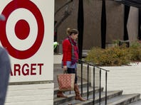 A customer pushes a cart outside of a Target store in Jersey City on Dec. 26.