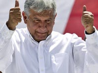 Andres Manuel Lopez Obrador, former presidential candidate of the Democratic Revolution Party (PRD), gives a thumbs up to his supporters at Mexico City's main plaza, the Zocalo, Sunday.