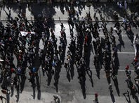 Protesters march to the Greek Parliament in Athens on Nov. 6.