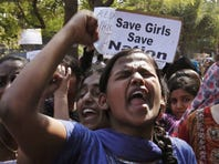 Indian students shout slogans during a protest rally in Hyderabad, India, Monday, Dec. 31.
