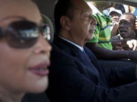 Former dictator Jean-Claude Duvalier drives away from the courthouse with longtime companion Veronique Roy, after attending a closed hearing in Port-au-Prince, Haiti, on Jan. 20.
