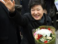 South Korea's new President Park Geun-hye waves to supporters while leaving her private residence for her inauguration ceremony at the National Assembly in Seoul, South Korea, Monday.
