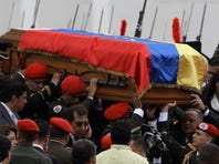 The coffin containing the remains of Venezuela's late President Hugo Chavez is carried from the military academy, at the start of a procession to the military museum, his final resting place, in Caracas, Venezuela, Friday.