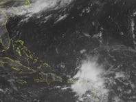 This NOAA satellite image taken on Wednesday shows Tropical Storm Barry over the Lesser Antilles.
