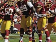 Washington Redskins linebacker Rob Jackson (50) celebrates his interception and touchdown with teammates.