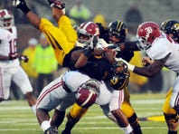 Alabama's LaMichael Fanning drives Missouri's Russell Hansbrough into the ground on a personal foul late in the Crimson Tide's 42-10 win Saturday.