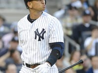 Yankees third baseman Alex Rodriguez heads to the dugout after striking out looking in the second inning in Game 1 on Saturday.