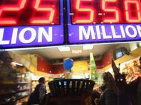 A sign outside the One Stop Mart shows the winning amounts for lottery games including the $550 million for the Powerball jackpot on November 28, 2012 in Chicago, Illinois.