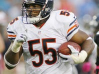 \Chicago Bears linebacker Lance Briggs is trailed by Jacksonville Jaguars wide receiver Mike Thomas  as he returns an interception for a 36-yard touchdown in the fourth quarter of their October game at EverBank Field. 20121007_jtl_ap6_251.jpg
