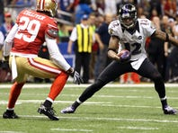 Baltimore Ravens wide receiver Jacoby Jones (12) makes a catch for a touchdown against San Francisco 49ers defensive back Chris Culliver (29) during the second quarter in Super Bowl XLVII at the Mercedes-Benz Superdome.