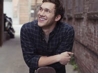 "Phillip Phillips' debut album, ""The World From the Side of the Moon,"" has sold nearly a quarter-million copies in its first two weeks of release."