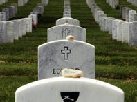 Stones with the word 'hero' written on them lay on grave stones in Section 60, where many soldiers from the Iraq and Afghanistan wars are buried.