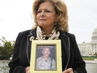 Vivianne Wersel, 59, a military widow, is one of a handful of women fighting against a law that strips military wives of certain benefits if their spouse dies and they choose not to remarry.