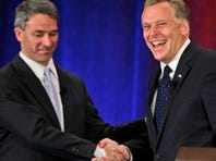 Republican gubernatorial candidate Ken Cuccinelli, left, greets Democrat Terry McCauliffe at the start of their debate at the Virginia Bar Association convention in Hot Springs, Va., on Saturday.