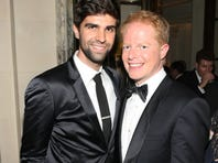 Justin Mikita and Jesse Tyler Ferguson attend the 2013 Tony Awards in June.