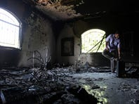 In this Thursday, Sept. 13, 2012 file photo, a Libyan man investigates the inside of the U.S. Consulate after an attack that killed four Americans, including Ambassador Chris Stevens, on the night of Tuesday, Sept. 11, 2012, in Benghazi, Libya. AP/Mohammad Hannon