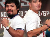 Former champions Manny Pacquiao and  Brandon Rios pose during a press conference in New York City Tuesday.