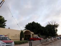 Libyan investigators' cars are parked in front of the U.S. Consulate in Benghazi, Libya.