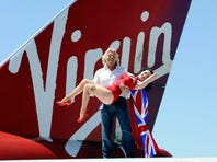 Founder and President of Virgin Group Sir Richard Branson (left) and burlesque artist Dita Von Teese appear on the wing of a Virgin Atlantic Airways 747-400 aircraft at McCarran International Airport June 15, 2010 in Las Vegas, Nevada. Branson is celebrating his British airline's 10th anniversary of flying between London and Las Vegas.