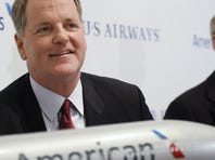 Doug Parker (left), US Airways, and Tom Horton, CEO of American Airlines, speak during a news conference to announce the merger of the two airlines on Feb. 14, 2013 in Dallas Texas.
