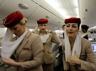 Emirates flight attendants prepare the inside an Airbus A380 aircraft for a flight at the new Concourse A of Dubai airport in Dubai, United Arab Emirates, on Feb. 10, 2013.
