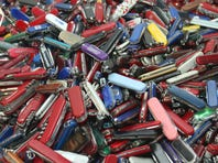 In this Sept. 26, 2006, file photo, knives of all sizes and types are piled in a box at the State of Georgia Surplus Property Division store in Tucker, Ga., and are just a few of the hundreds of items discarded at the security checkpoints of Hartsfield-Jackson Atlanta International Airport that will be for sale at the store.