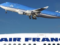 In this file photo from Jan. 1, 2003, a KLM Boeing 747-400 takes off within view of an Air France plane at Amsterdam's airport.