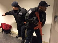 Naval District Washington police officers train for active shooters five months after the attack at the Navy Yard.
